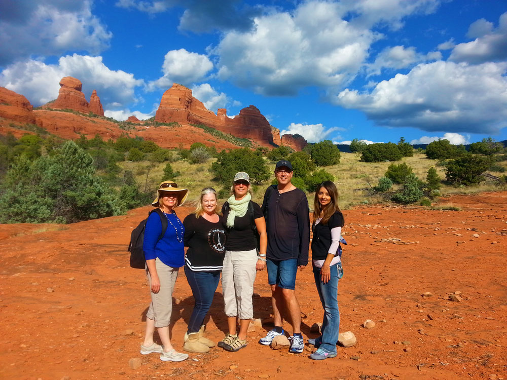 SpiritQuest Retreats owner Katherine Lash out on the land with clients during a retreat